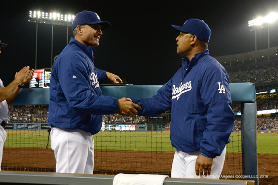 Bob Geren and Dave Roberts congratulate each other after win against the St. Louis Cardinals Saturday, May 14, 2016 at Dodger Stadium in Los Angeles, California.  Jon SooHoo/©Los Angeles Dodgers,LLC 2016