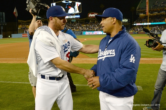 Los Angeles Dodgers Scott Kazmir is congratulated by Dave Roberts after win against the St. Louis Cardinals Saturday, May 14, 2016 at Dodger Stadium in Los Angeles, California.  Jon SooHoo/©Los Angeles Dodgers,LLC 2016