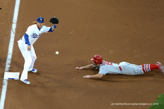 Los Angeles Dodgers Justin Turner takes throw against the St. Louis Cardinals Sunday, May 15, 2016 at Dodger Stadium in Los Angeles, California.  Jon SooHoo/©Los Angeles Dodgers,LLC 2016
