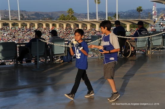 Great Los Angeles Dodgers fans enjoy ice cream during game Sunday, May 15, 2016 at Dodger Stadium in Los Angeles, California.  Jon SooHoo/©Los Angeles Dodgers,LLC 2016