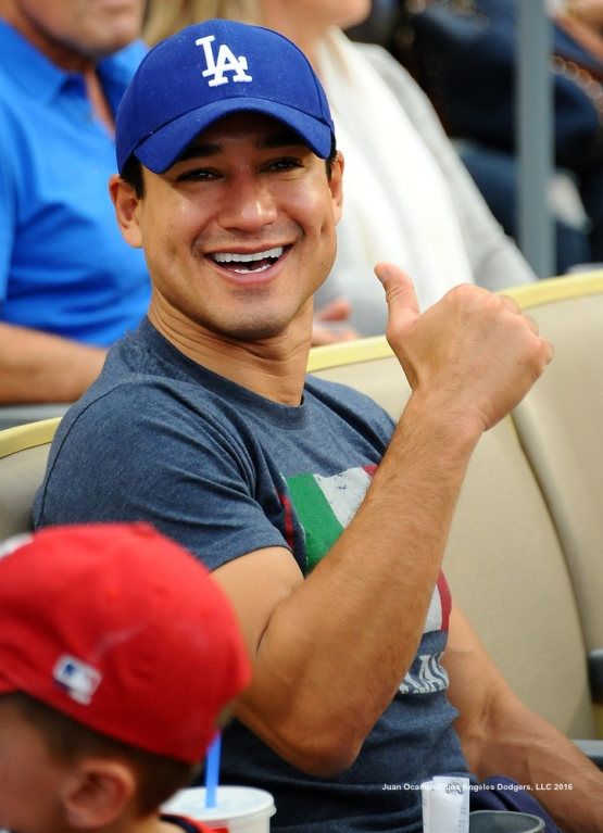 Actor Mario Lopez takes in the game.
