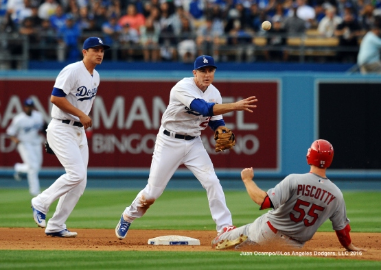 Chase Utley forces out the Cardinals' Stephen Piscotty at second base to start the double-play.