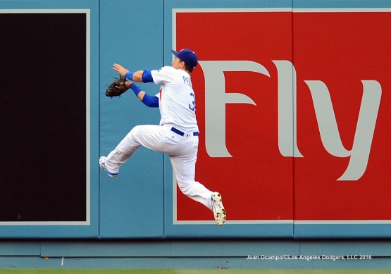 Joc Pederson leaps to make the catch.