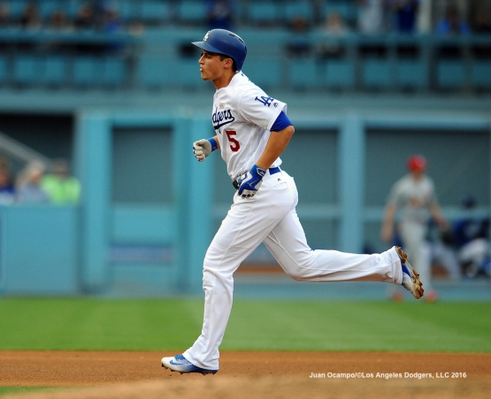 Corey Seager rounds the bases after hitting a home run.
