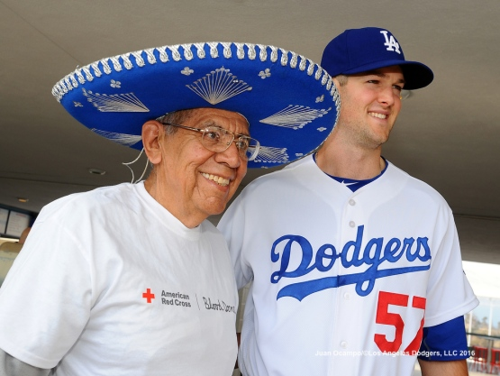 Alex Wood poses for a photo with a fan on the Top Deck of Dodger Stadium before the game against the Angels.