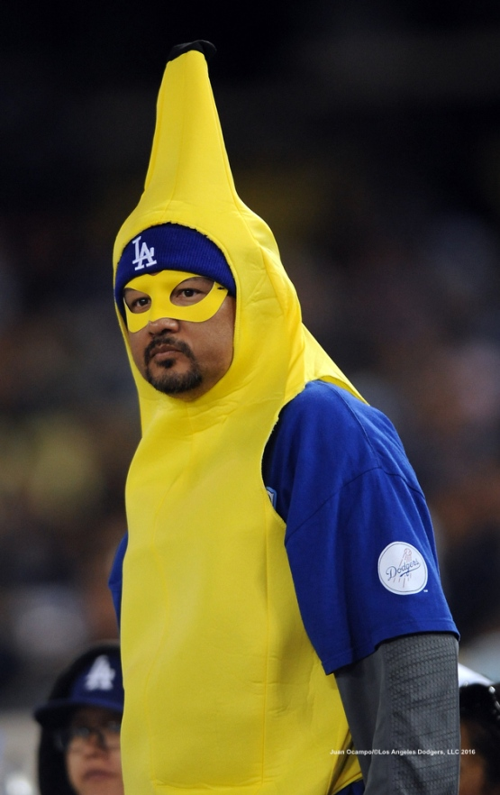 "A Dodger fan watches the game in a ""Rally Banana"" outfit."