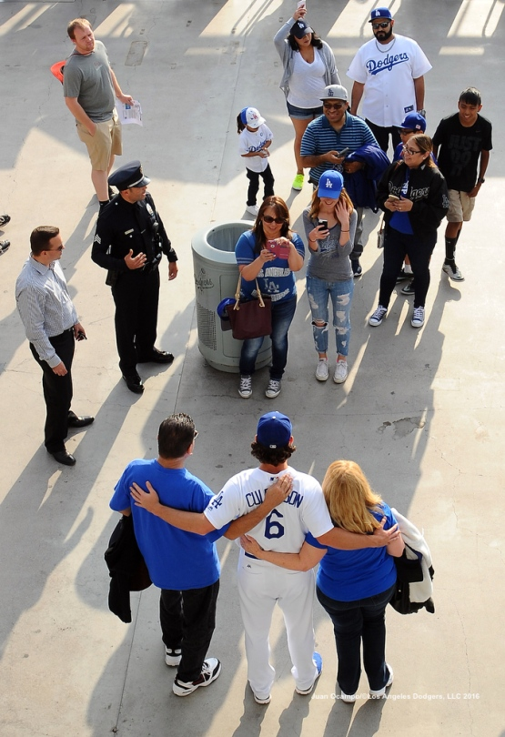 Charlie Culberson poses for a photo with fans on the Reserve Level of Dodger Stadium.