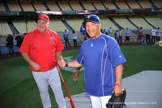 Mike Scioscia and Dave Roberts talk prior to game against the Los Angeles Angels of Anaheim Tuesday, May 17, 2016 at Dodger Stadium in Los Angeles, California.  Jon SooHoo/©Los Angeles Dodgers,LLC 2016