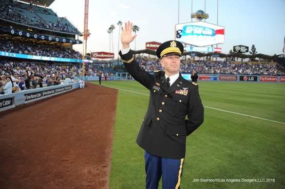 Los Angeles Dodgers Military Hero of the game US Army Reserves Chief Warrant Officer, Kirk Stricker waves to the crowd during game against the Los Angeles Angels of Anaheim Tuesday, May 17, 2016 at Dodger Stadium in Los Angeles, California.  Jon SooHoo/©Los Angeles Dodgers,LLC 2016