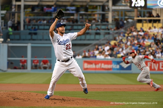 Los Angeles Dodgers Clayton Kershaw leaps for ball during game against the Los Angeles Angels of Anaheim Tuesday, May 17, 2016 at Dodger Stadium in Los Angeles, California.  Jon SooHoo/©Los Angeles Dodgers,LLC 2016