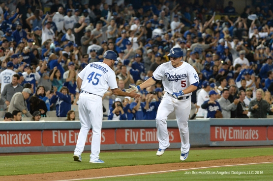 Los Angeles Dodgers Corey Seager is greeted by third base coach Chris Woodward after home run against the Los Angeles Angels of Anaheim Tuesday, May 17, 2016 at Dodger Stadium in Los Angeles, California.  Jon SooHoo/©Los Angeles Dodgers,LLC 2016