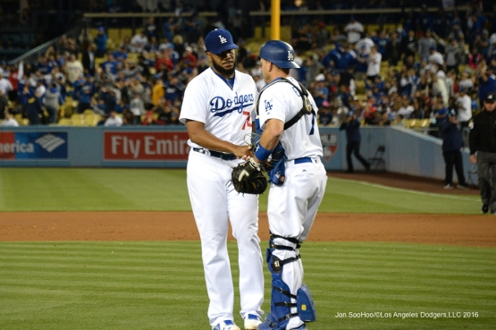 Los Angeles Dodgers Kenley Jansen shakes hands with A.J.Ellis after defeating the Los Angeles Angels of Anaheim Tuesday, May 17, 2016 at Dodger Stadium in Los Angeles, California.  Jon SooHoo/©Los Angeles Dodgers,LLC 2016