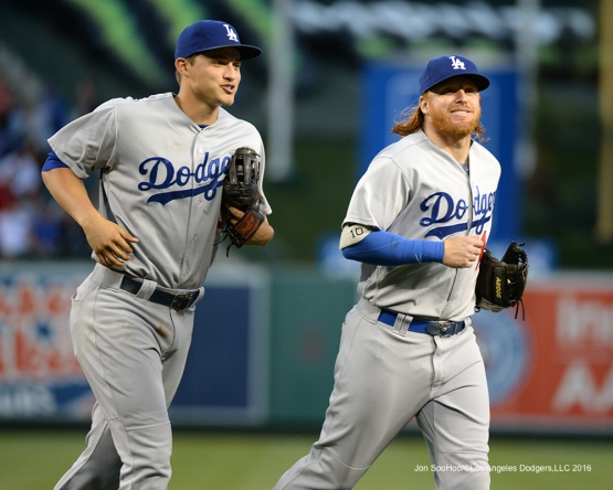 Corey Seager and Justin Turner head to dugout during game against the Los Angeles Angels of Anaheim Wednesday, May 18, 2016 at Angels Stadium in Anaheim, California.  Jon SooHoo/©Los Angeles Dodgers,LLC 2016