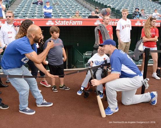 A.J. Ellis poses with young fan prior to game against the Los Angeles Angels of Anaheim Thursday, May 19, 2016 at Angels Stadium in Anaheim, California.  Jon SooHoo/©Los Angeles Dodgers,LLC 2016