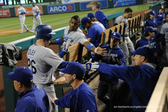 Chase Utley is greeted by teammates after scoring against the Los Angeles Angels of Anaheim Thursday, May 19, 2016 at Angels Stadium in Anaheim, California.  Jon SooHoo/©Los Angeles Dodgers,LLC 2016