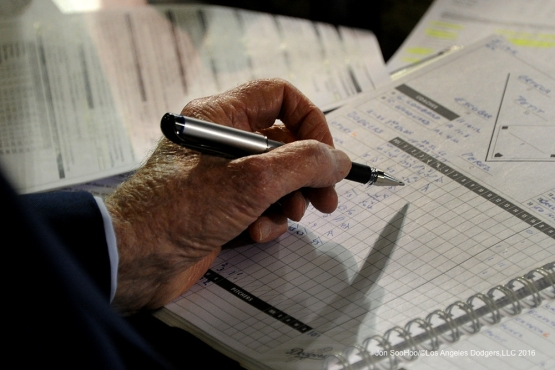 Vin Scully and scorebook during game against the Los Angeles Angels of Anaheim Thursday, May 19, 2016 at Angels Stadium in Anaheim, California.  Jon SooHoo/©Los Angeles Dodgers,LLC 2016