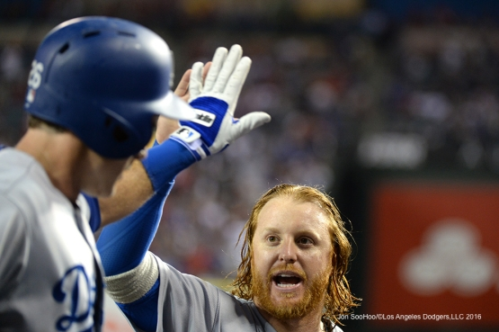 Justin Turner high fives Chase Utley during game against the Los Angeles Angels of Anaheim Thursday, May 19, 2016 at Angels Stadium in Anaheim, California.  Jon SooHoo/©Los Angeles Dodgers,LLC 2016