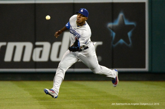 Yasiel Puig runs down ball against the Los Angeles Angels of Anaheim Thursday, May 19, 2016 at Angels Stadium in Anaheim, California.  Jon SooHoo/©Los Angeles Dodgers,LLC 2016