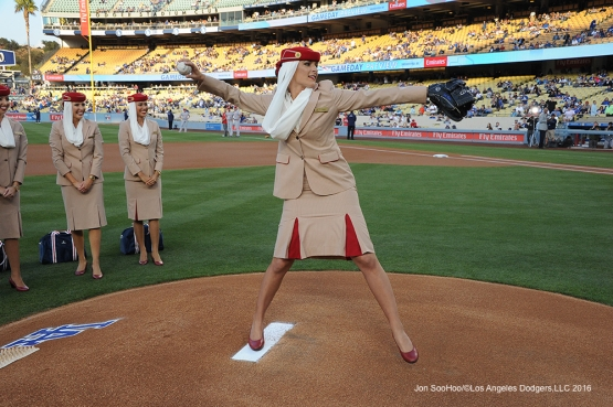 Emirates Airline flight attendants throws out the first pitch prior to game against the Cincinnati Reds Monday, May 23,2016 at Dodger Stadium in Los Angeles,California. Photo by Jon SooHoo