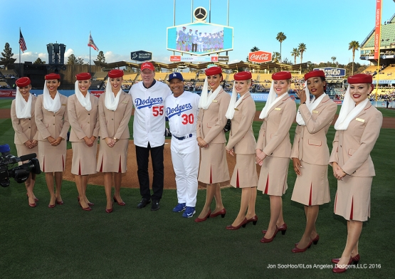 Emirates Airline flight attendants pose with Orel Hershiser and Dave Roberts prior to game against the Cincinnati Reds Monday, May 23,2016 at Dodger Stadium in Los Angeles,California. Photo by Jon SooHoo