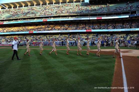 Emirates Airline flight attendants head off the field prior to game against the Cincinnati Reds Monday, May 23,2016 at Dodger Stadium in Los Angeles,California. Photo by Jon SooHoo