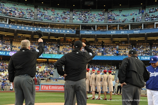 Umpires wave to Vin Scully prior to game against the Cincinnati Reds Monday, May 23,2016 at Dodger Stadium in Los Angeles,California. Photo by Jon SooHoo