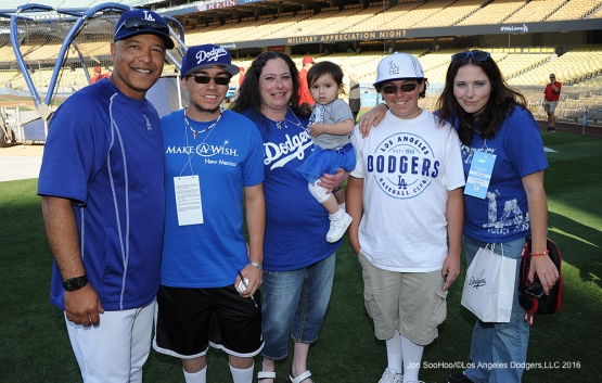 Great Los Angeles Dodger fans and Dave Roberts pose prior to game against the Cincinnati Reds Tuesday, May 24, 2016 at Dodger Stadium in Los Angeles,California. Photo by Jon SooHoo