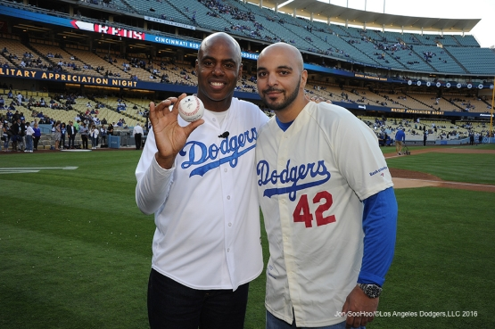 Kevin Frazier and son, Tony Tull pose prior to game against the Cincinnati Reds Tuesday, May 24, 2016 at Dodger Stadium in Los Angeles,California. Photo by Jon SooHoo