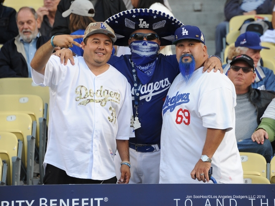 Great Los Angeles Dodger fans pose prior to game against the Cincinnati Reds Tuesday, May 24, 2016 at Dodger Stadium in Los Angeles,California. Photo by Jon SooHoo