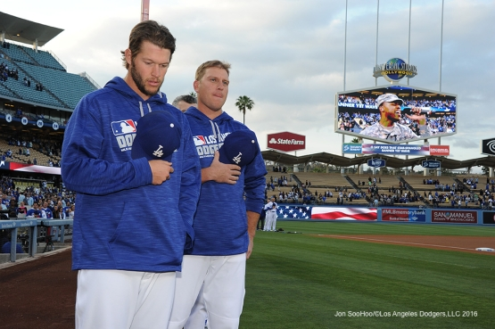 Clayton Kershaw and A.J.Ellis stand for the anthem prior to game against the Cincinnati Reds Tuesday, May 24, 2016 at Dodger Stadium in Los Angeles,California. Photo by Jon SooHoo