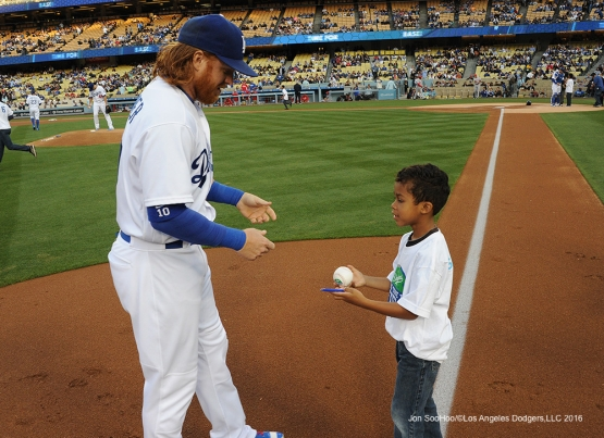 Los Angeles Dodgers Justin Turner signs  prior to game against the Cincinnati Reds Tuesday, May 24, 2016 at Dodger Stadium in Los Angeles,California. Photo by Jon SooHoo