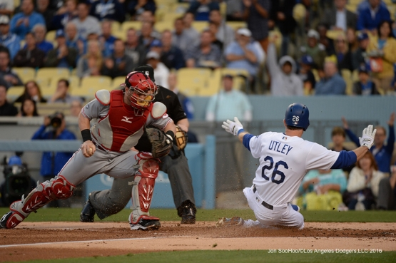 Chase Utley scores against the Cincinnati Reds Tuesday, May 24, 2016 at Dodger Stadium in Los Angeles,California. Photo by Jon SooHoo