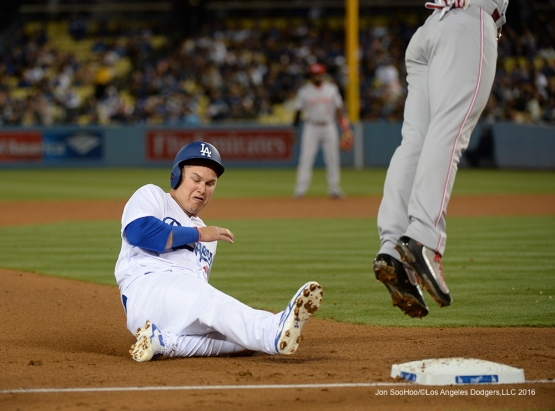 Joc Pederson slides into third against the Cincinnati Reds Tuesday, May 24, 2016 at Dodger Stadium in Los Angeles,California. Photo by Jon SooHoo