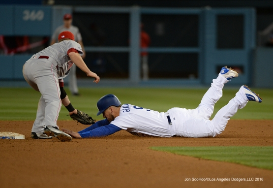 Yasmani Grandal is out at second against the Cincinnati Reds Tuesday, May 24, 2016 at Dodger Stadium in Los Angeles,California. Photo by Jon SooHoo