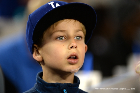 Young great Los Angeles Dodgers fan during game against the Cincinnati Reds Tuesday, May 24, 2016 at Dodger Stadium in Los Angeles,California. Photo by Jon SooHoo