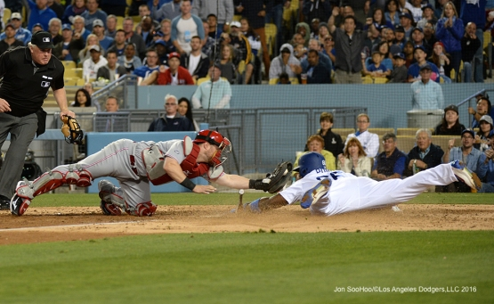 Yasiel Puig is safe at home during game against the Cincinnati Reds Tuesday, May 24, 2016 at Dodger Stadium in Los Angeles,California. Photo by Jon SooHoo