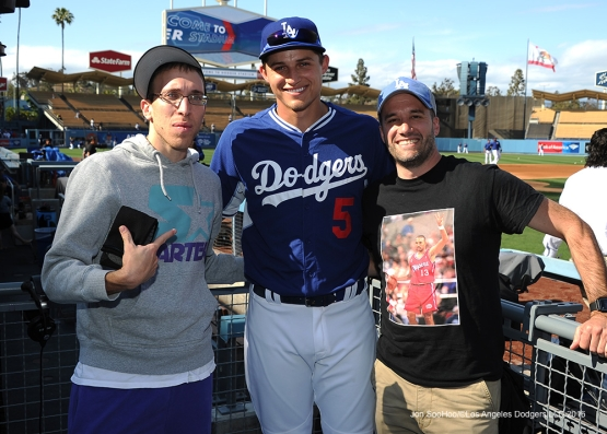 Great Los Angeles Dodger fans pose with Corey Seager prior to game against the Cincinnati Reds Wednesday, May 25, 2016 at Dodger Stadium in Los Angeles,California. Photo by Jon SooHoo