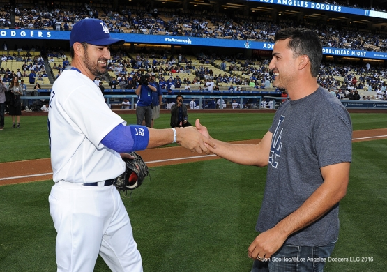 Adrian and Edgar Gonzalez shake hands after ceremonial first pitch prior to game against the Cincinnati Reds Wednesday, May 25, 2016 at Dodger Stadium in Los Angeles,California. Photo by Jon SooHoo