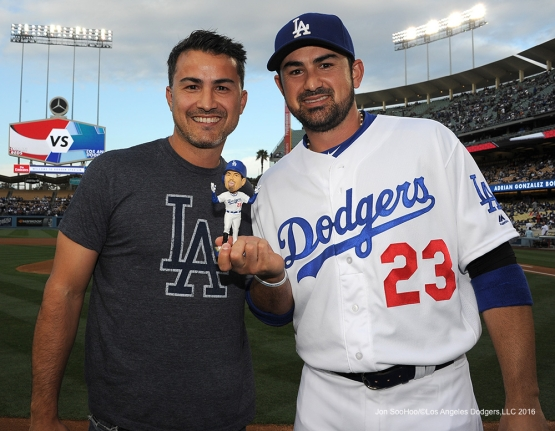 Adrian and Edgar Gonzalez hold Adrian's Bobblehead after ceremonial first pitch before game against the Cincinnati Reds Wednesday, May 25, 2016 at Dodger Stadium in Los Angeles,California. Photo by Jon SooHoo