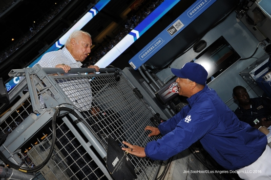 Tommy Lasorda and Dave Roberts talk during game against the Cincinnati Reds Wednesday, May 25, 2016 at Dodger Stadium in Los Angeles,California. Photo by Jon SooHoo