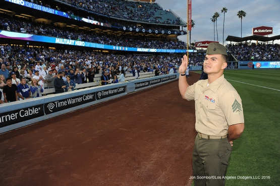 Military Hero of the Game US Marine Corp Sergeant, Miguel Aguilar waves to the crowd during game against the Cincinnati Reds Wednesday, May 25, 2016 at Dodger Stadium in Los Angeles,California. Photo by Jon SooHoo