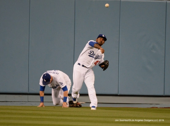 Los Angeles Dodgers Howie Kendrick throws the ball in during game  against the Cincinnati Reds Wednesday, May 25, 2016 at Dodger Stadium in Los Angeles,California. Photo by Jon SooHoo