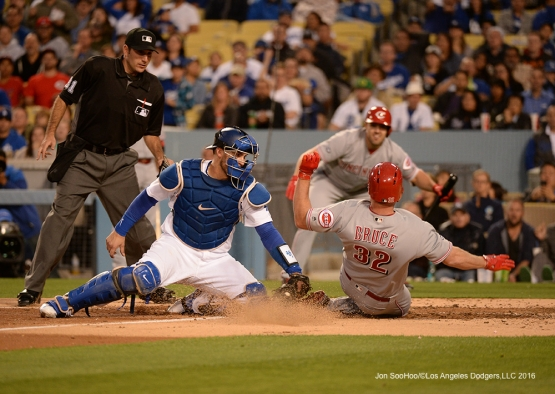 Yasmani Grandal tags out the runner at home during game against the Cincinnati Reds Wednesday, May 25, 2016 at Dodger Stadium in Los Angeles,California. Photo by Jon SooHoo