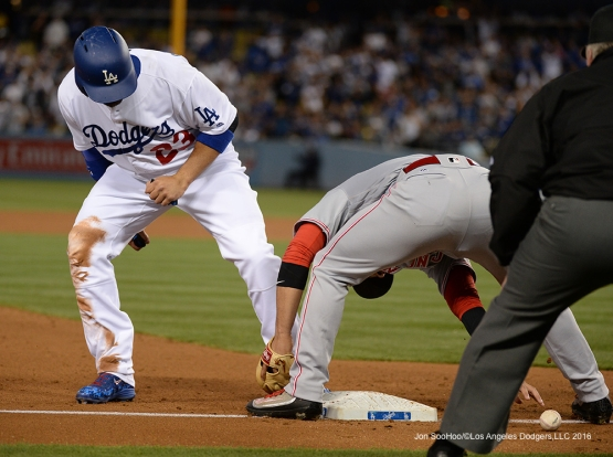 Adrian Gonzalez is safe at third during game against the Cincinnati Reds Wednesday, May 25, 2016 at Dodger Stadium in Los Angeles,California. Photo by Jon SooHoo