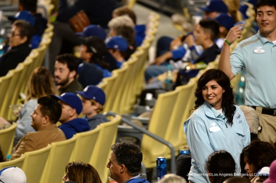Great Los Angeles Dodgers usher smiles during  game against the Cincinnati Reds Wednesday, May 25, 2016 at Dodger Stadium in Los Angeles,California. Photo by Jon SooHoo