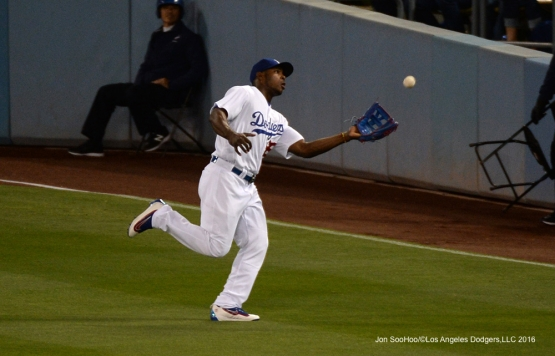 Yasiel Puig runs down fly ball against the Cincinnati Reds Wednesday, May 25, 2016 at Dodger Stadium in Los Angeles,California. Photo by Jon SooHoo