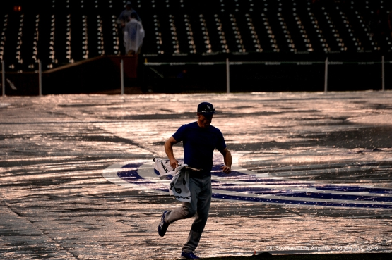 Los Angeles Dodgers Chase Utley heads to the batting cage during the rain Tuesday, May 31,2016 at Wrigley Field in Chicago,Illinois. Photo by Jon SooHoo/©Los Angeles Dodgers,LLC 2016