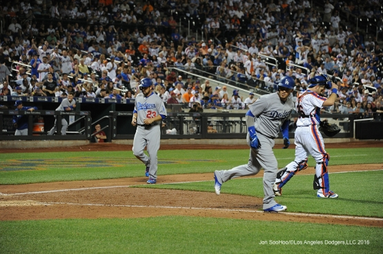 Los Angeles Dodgers Adrian Gonzalez scores on Yasmani Grandal walk during game against the New York Mets Friday, May 27, 2016 at Citi Field in Flushing,New York.