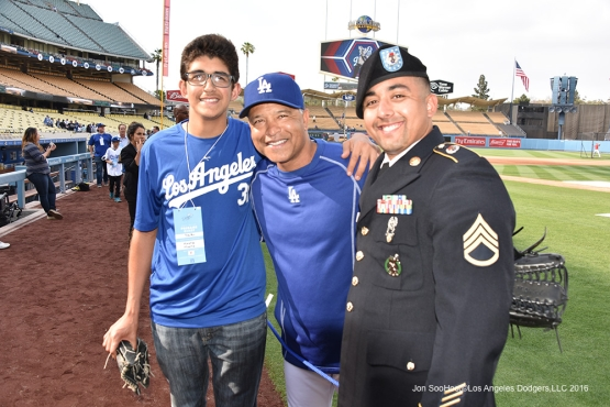 Dave Roberts poses with Military Hero Jesus Martinez prior to game against the Los Angeles Angels of Anaheim Monday, May 16, 2016 at Dodger Stadium in Los Angeles, California.  Jon SooHoo/©Los Angeles Dodgers,LLC 2016