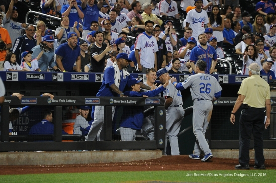 Los Angeles Dodgers Chase Utley is greeted by teammates after tying the game in the ninth inning against the New York Mets Friday, May 27, 2016 at Citi Field in Flushing,New York.